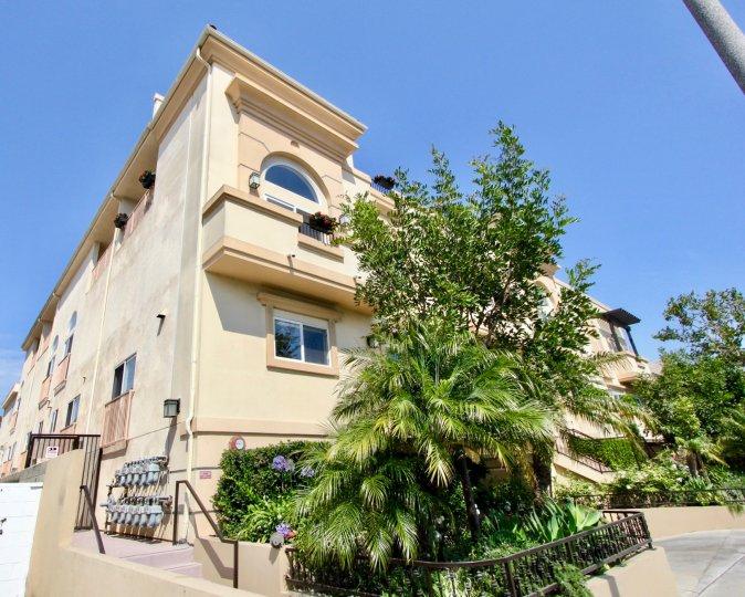 beautiful blue sky, green surroundings the Granville Homes Apartment building, West La, California