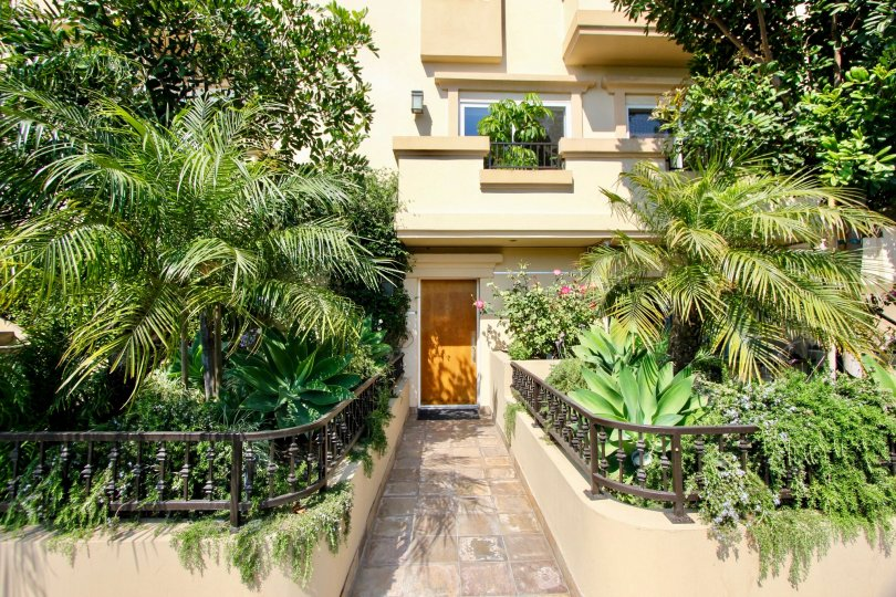 Exterior entrance of house surrounded by vegetation in Granville Homes West LA California