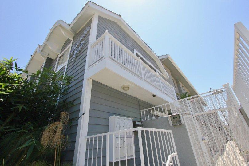 A grey house in the Sawtelle Ritz neighborhood on a sunny day.