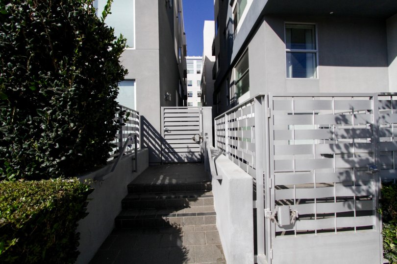 The privacy fence around Soho Square units in West LA