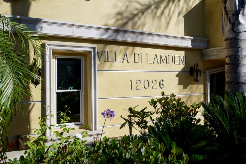 The sign on the building showcasing Villa di Lamdeni of West LA