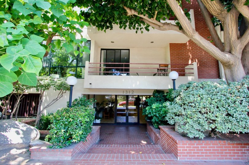Beautiful brick house surrounded with flowers and trees at VIP Saltair in West LA California
