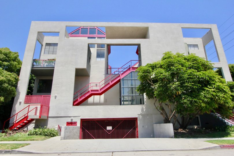 red staircases and weird angles make this apartment complex look different but in a bad way