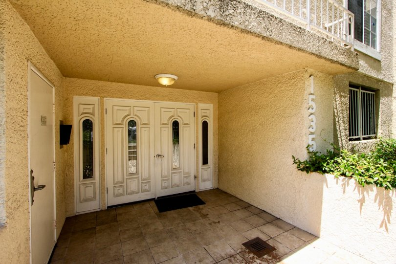 Stone entrance with tiles to Westwood Bentley in West LA, CA.