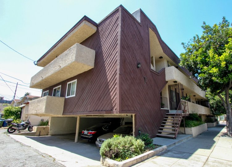 A purple painted Boat like structure house in Wyoming Condos in West LA California with Underground parking