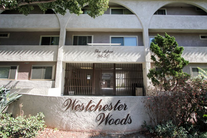 The Westchester Woods name on the building