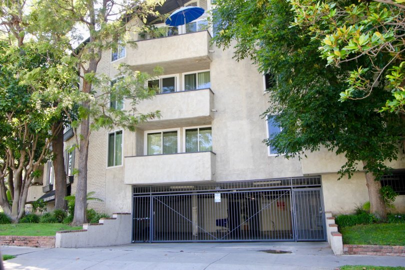 Underground garage entrance below 3 story apartment complex in Westwood, California.
