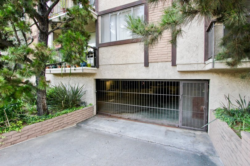A house surrounded by trees in Park Almayo with underground garage visible