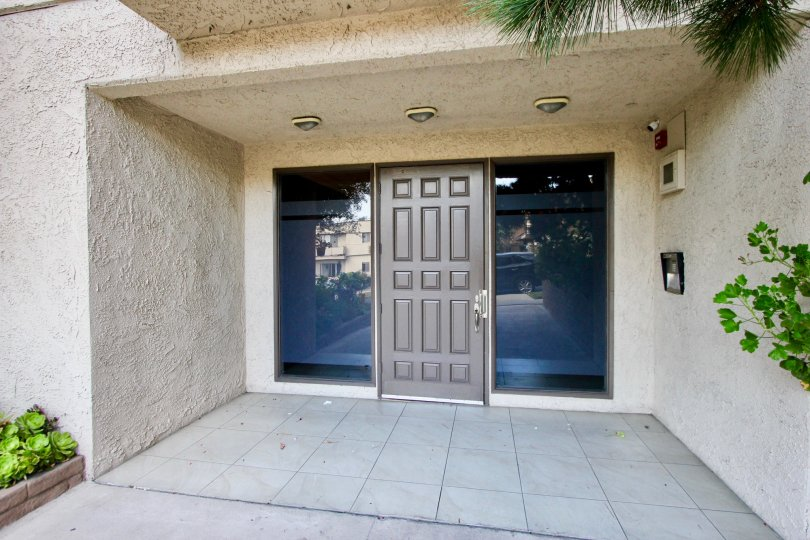 A gray door with tinted windows at a residence in the Park Almayo community