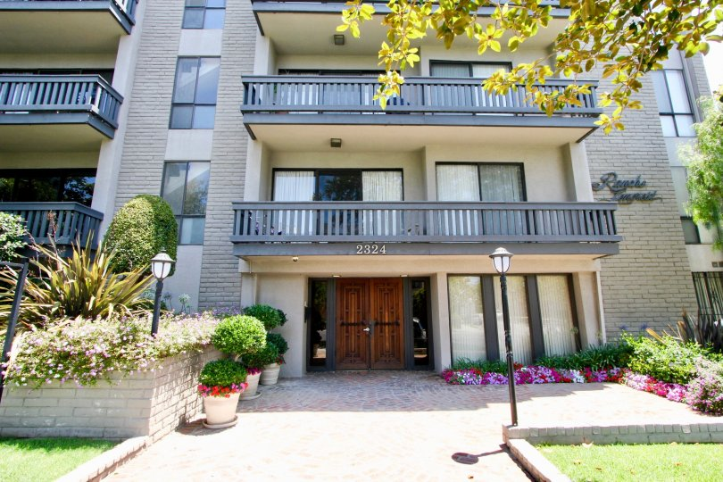 A stunning view of an apartment with colorful flowers and lights infront in Rancho Lencrest.
