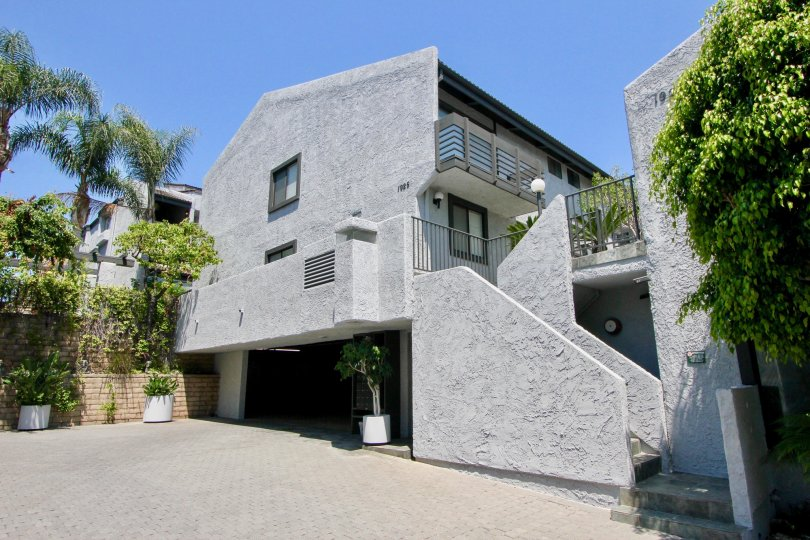 Cement colored triangular building in Glen townhomes villa.
