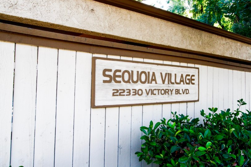 The welcoming sign into Sequoia Village in CA California
