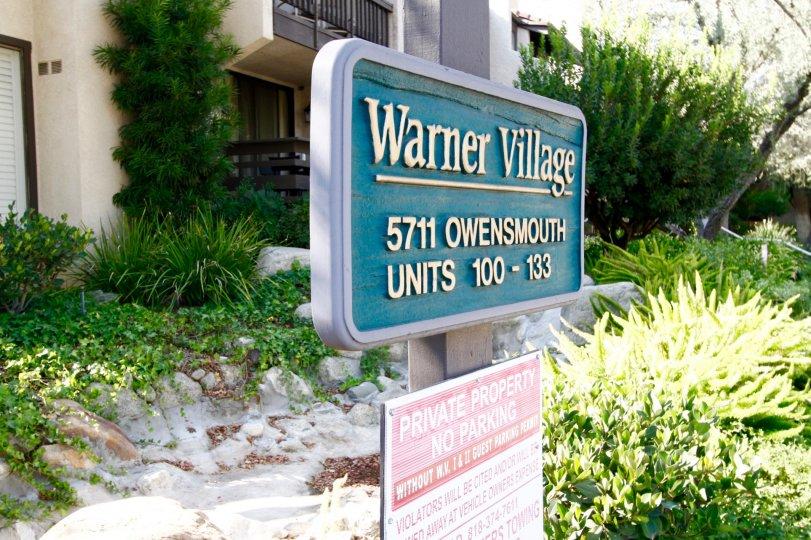 The Warner Village sign