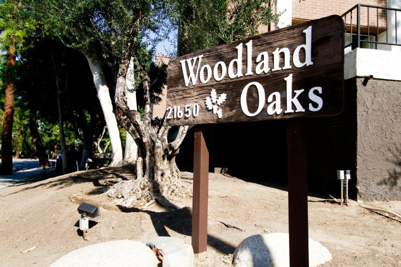 The sign welcoming you to Woodland Oaks in CA California