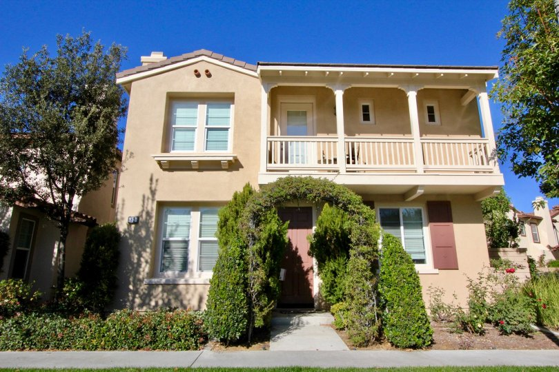 A sunny day at a two-story house in the Lauerel Quail Hill Community in Irvine California.