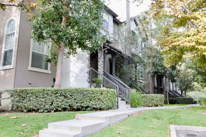 Unique stone columns and the lush yard make this Camden Park walkup stand out from the crowd.