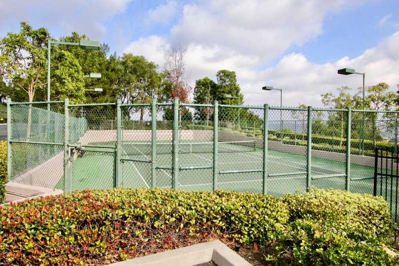 Lighted and enclosed tennis courts for residents of La Mirage.
