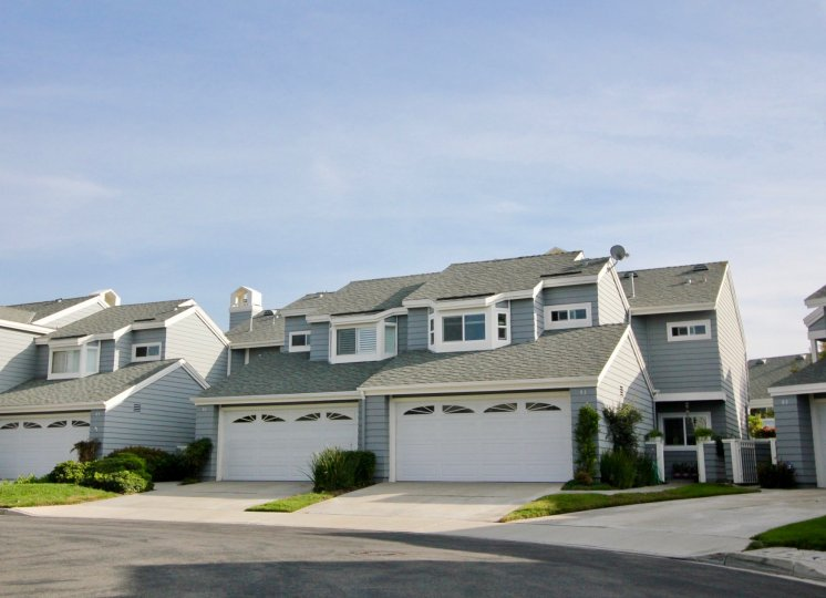 Side by side town homes with attached garages inside Laurelmont in Aliso Viejo CA