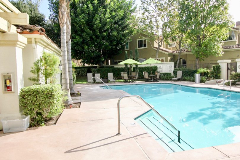 Beautiful outdoor pool with ample shady seating, located in the Montelena community of Aliso Viejo, California