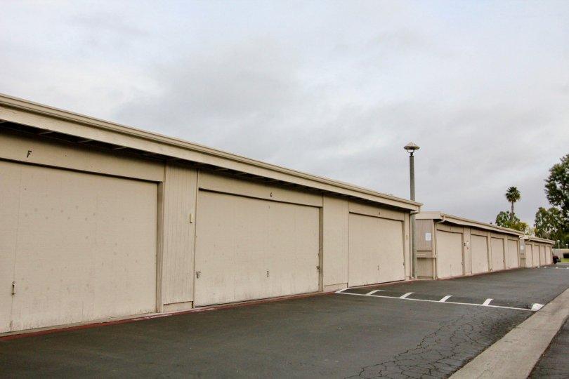 A row of storage units lined on the street of New World Condos.
