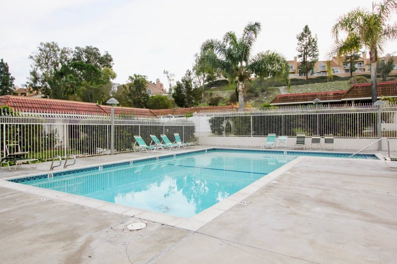 Nice swimming pool and sitout with trees around in New World Condos of Aliso Viejo