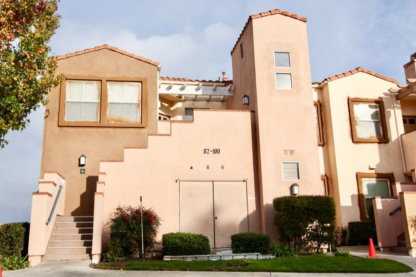 A multi level Spanish style building houses several units in Seacove Villas.