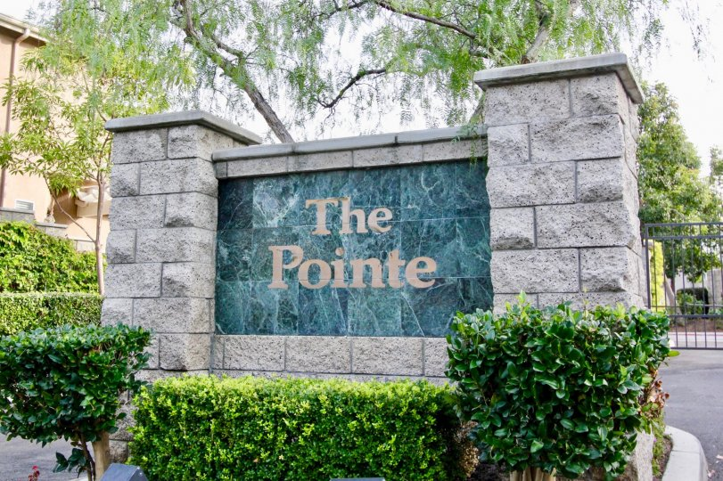 The entrance wall of the 'the point' with some shrubs and trees also.