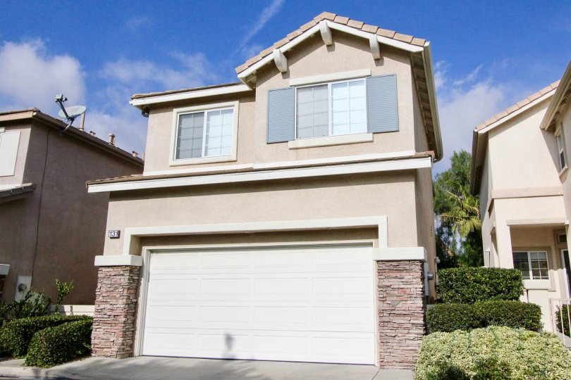 House with windows and a garage in the Victoria Community in Aliso Viejo, CA.