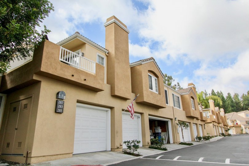 Apartments with garages and a cloudy sky in the Villas South Community in Aliso Viejo, CA.