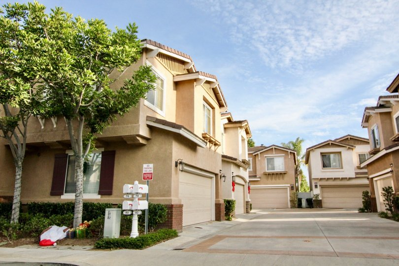 Sunny sky with apartments and garages and trees in the Vista Heights Community in Aliso Viejo, CA.