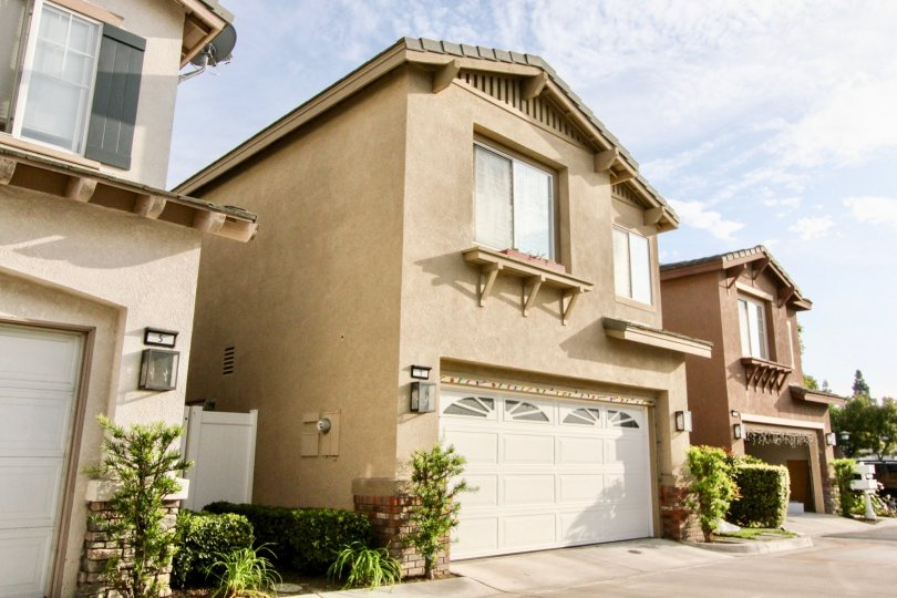 A two floor home with a garage located in sunny Aliso Viejo, California.