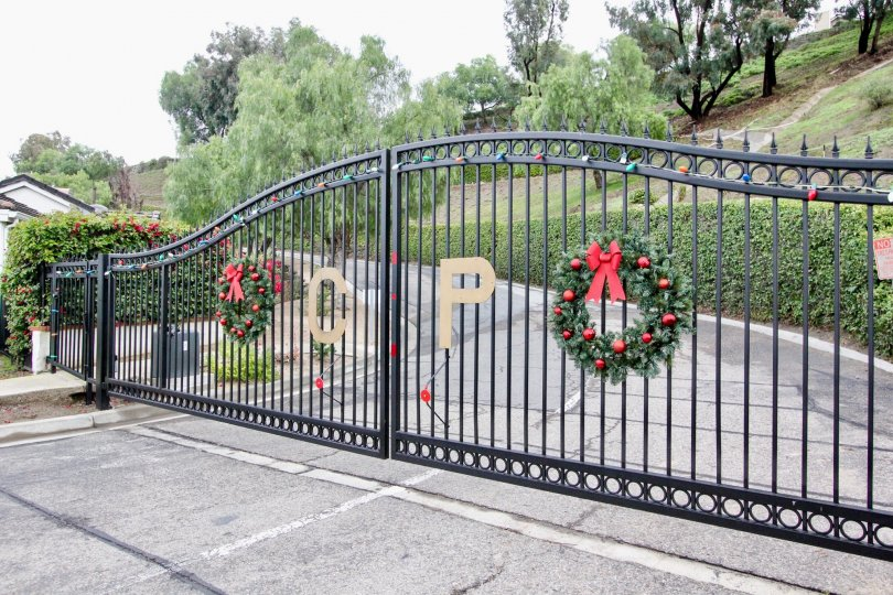 Decorated front entrance gate in front of the compound in Crown Pointe