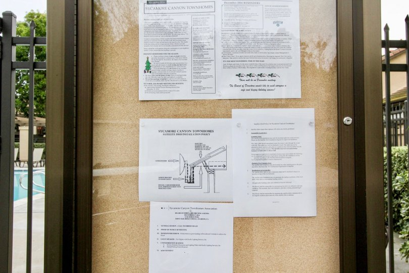In Notice board of the Apartment in Laurelwood at Sycamore Canyon has four papers that define the Townhomes