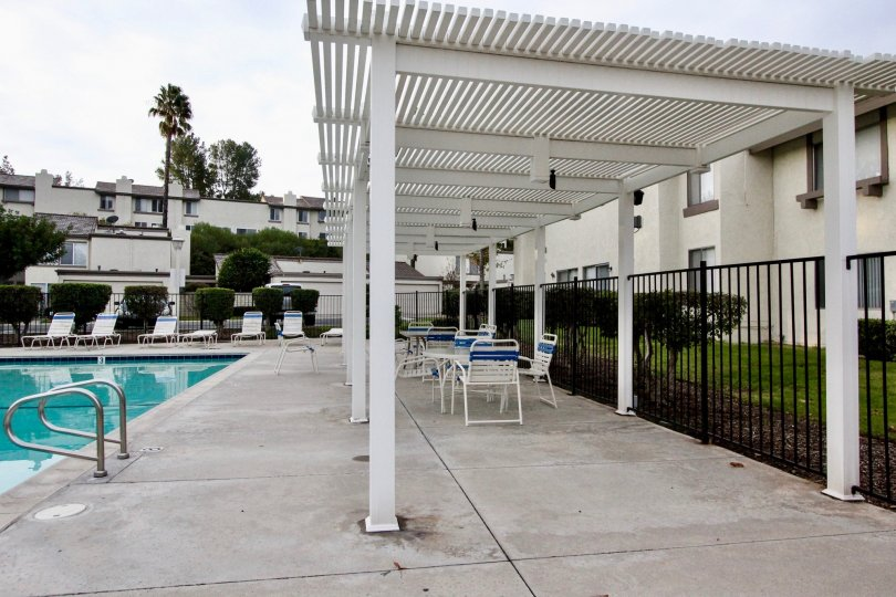 THE FLAT IN THE RANCHO YORBA WITH THE SWIMMING POOL, CHAIRS, LAWN