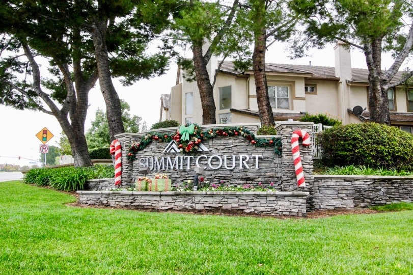 The view of the Summit Court community sign decorated for the Christmas season.