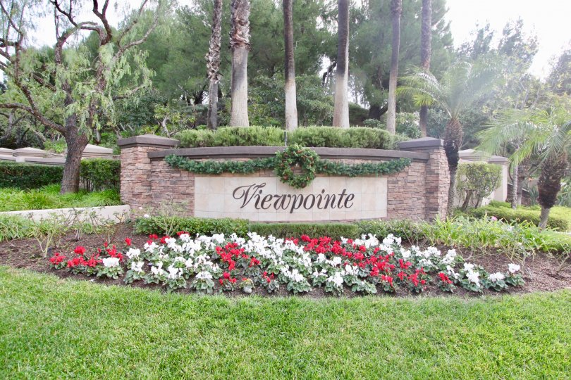 The Viewpointe with nice green grass around and lots of flowers and trees