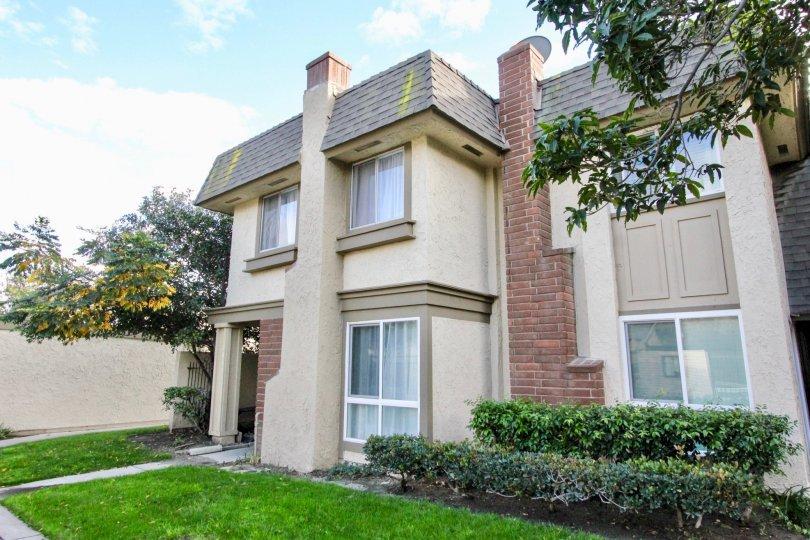 Hut style condominiums with a red brick chimney inside Anaheim Gardens in Anaheim CA