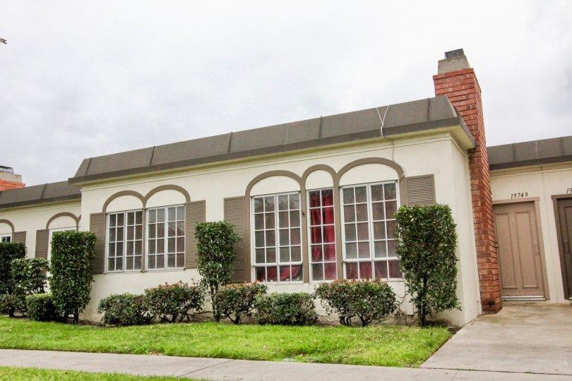 White home with brown trim and windows at Anaheim Village III in Anaheim CA