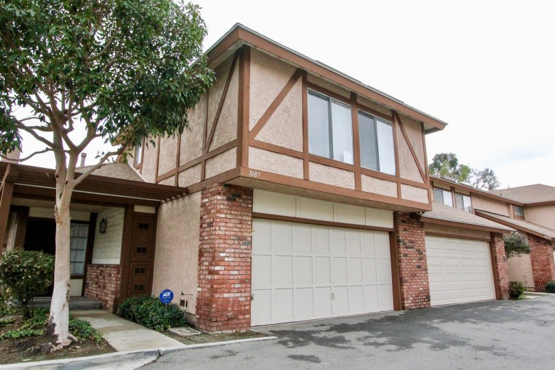 Beige brown home with brick sections in Bramble Village, Anaheim CA