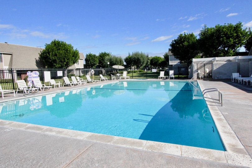 sunny day at the community pool of Broadmoor Arms in the city of Anaheim, california