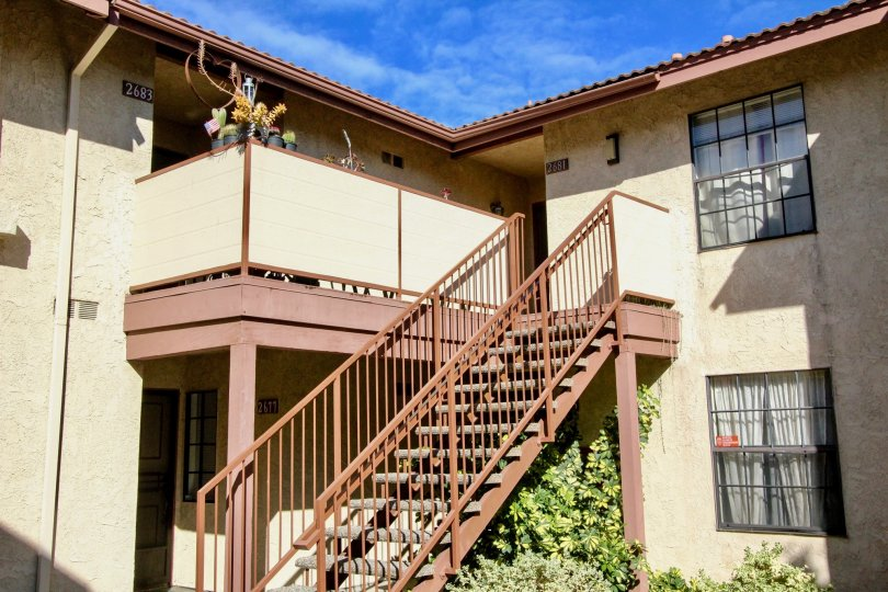 The stairs to an upper level of units at the Cameron Court community on a sunny day