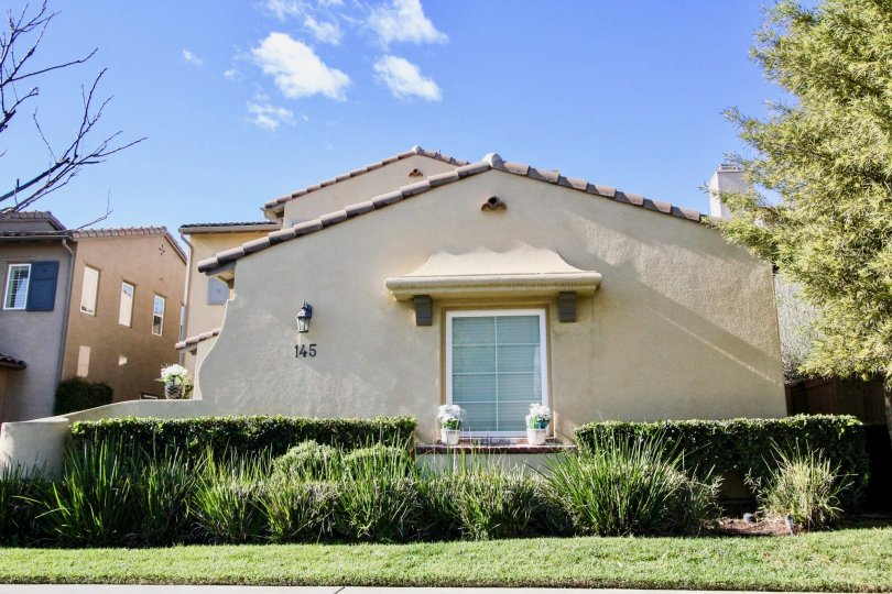 Sloped brown house with brick roof in Cantada Square, Anaheim CA