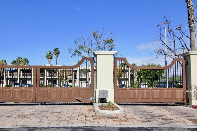 Sunny day showing the community gate of Cantada Square in the city of Anaheim, California