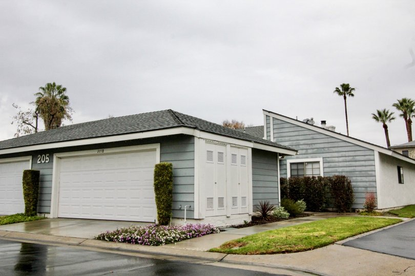 THE SHEDS WITH LAWN, CROTON PLANTS, NUMBER ON THE WALL ARE SHOWN IN ANAHEIM CITY
