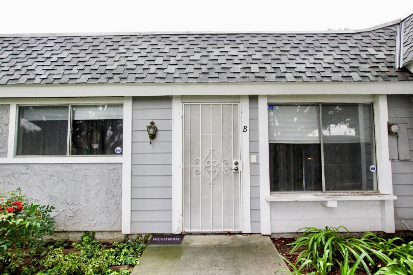A bungalow in the Casa Canon community with sliding windows and gated front door.
