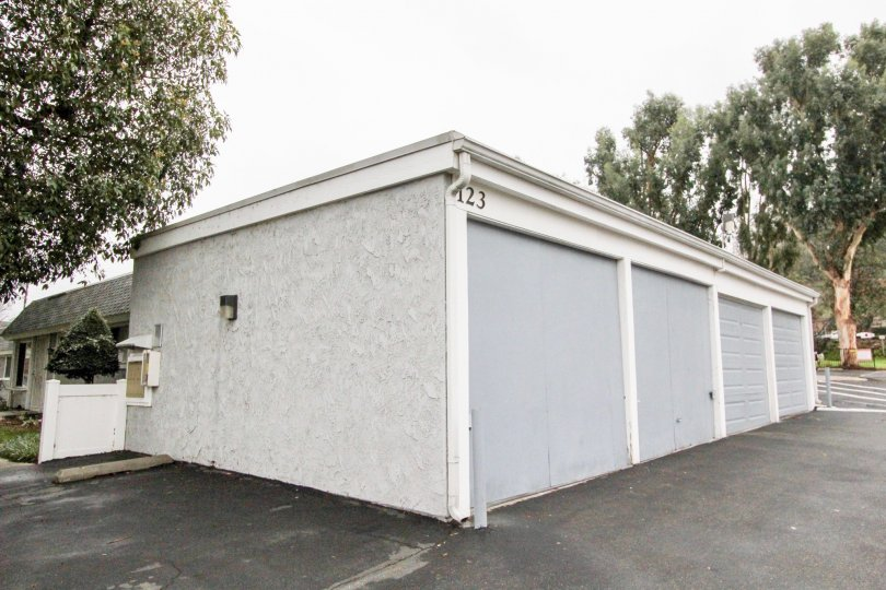 Simple white-gray garage and tree in Casa Canon, Anaheim CA