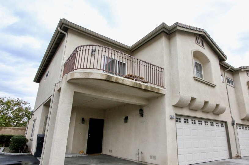 A large white home with garage in Citrus Villas community in Anaheim, California.
