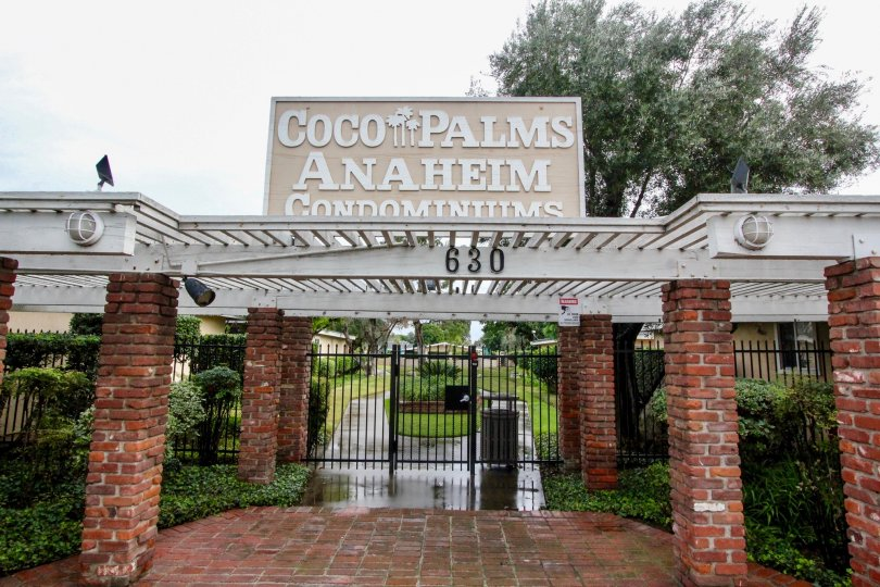 a pleasant day in the coco palms with park that has numbered as 630 and stone walls and entrance gate closed