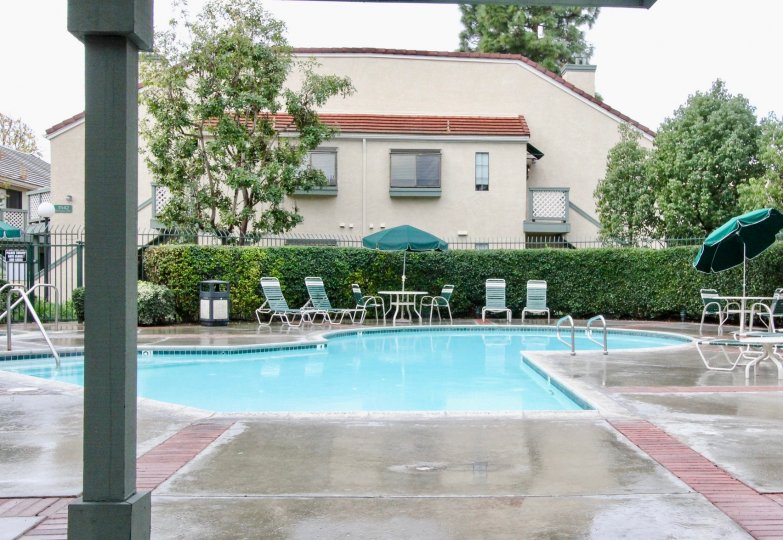 Evergreen Village community pool on a wet day in Anaheim California.