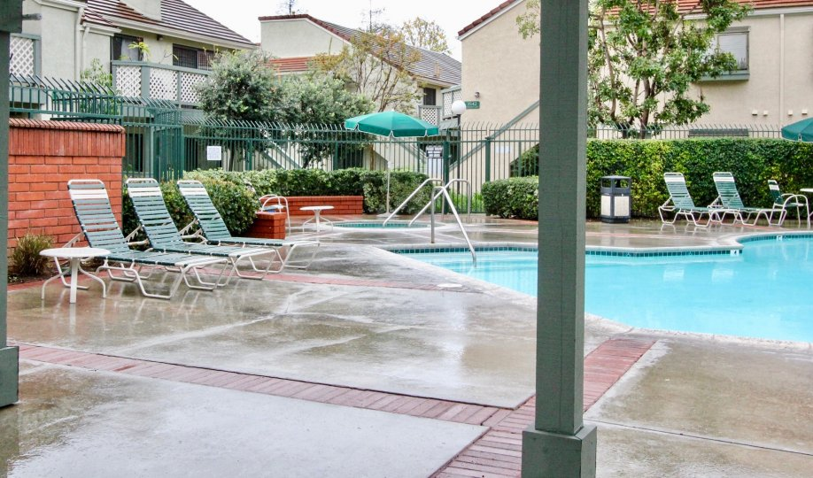 Awesome swimming pool between villas with sitting and garden in Evergreen Village of Anaheim